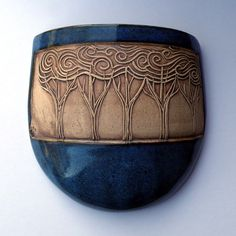 scami store etsy wall sconce hand carved stamp curly trees pottery ceramics clay slab