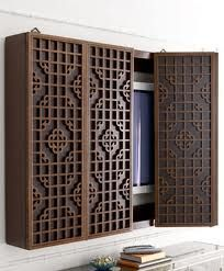 TV wall cabinet to hide it. Great idea, but try a different cabinet style here
