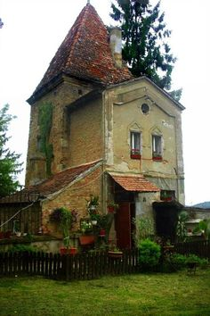 Romantic stone cottage with tower and red tiles roof. South/Southeast French countryside                  .....................from: Standout-Cabin-Designs.com