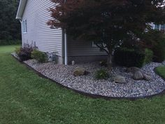 Removed old mulch, added fresh landscape paper and edger from Lowes, topped with easy maintenance river rock #3.