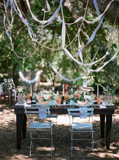 rustic and romantic tablescape and ribbons and rope draped from tree branches