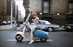 joel meyerowitz- the car and the scooter and the dress all match, perfect timing