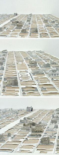 Larameeee — cut newspaper installation by pat shannon
