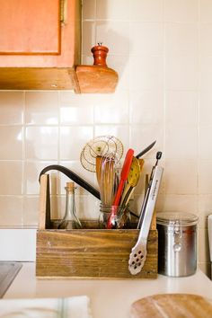"""A great option for organizing kitchen utensils & frequently used spices, etc. is to combine smaller containers inside of a larger one. Or keep items in containers clustered together on trays or in baskets (lined with a cut-to-fit plastic place mat for easy cleaning.) I have trays on each side at the back of my sink~ one to hold soap & lotion dispensers and the other with 1/2"""" high sides to hold the sink stopper, pot brush & scrubbies so water doesn't get on the counter while they're drying…"""