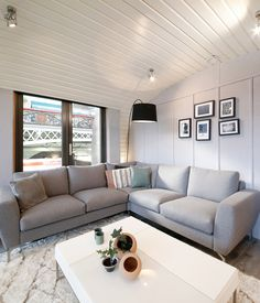 The Monaco Corner Sofa in grey, beautifully placed in the Sustainable ARC Home