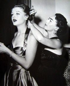 True Friendship: Joan Crawford fixing Angela Lansbury's hair. Friends don't let friends out with Bad hair.