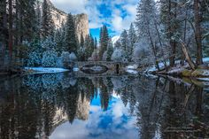 Looking as if it were lightly dusted in powdered sugar Yosemite Fall colors turn to sweet Winter hues. The walk down to the river was nippy cold as sunlight hit Washington Column and lit up the scenery below. The snow crunched beneath or boots but our breath was taken away by Mother Nature's early Christmas present. We stayed as long as we could with long pauses to just enjoy being there in the moment. © Darvin Atkeson YosemiteLandscapes.com