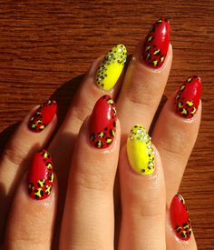 red and neon yellow nails with animal prints and rhinestones, cheetah print, leopard nails, wild nails, natural nails, silver rhinestones and glitter, natural nails, almond shape, nail art at home