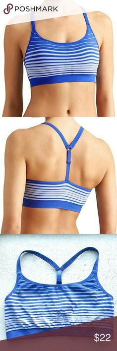 Athleta Up-Tempo Energy Stripe The Unstinkable seamless bra in a T-back design and an eye-catching ombre stripe. T-back design gives your arms freedom to move INSPIRED FOR: gym/training, studio workouts. 48% polyester, 41% nylon, 11% spandex.  In excellent condition. Removable pads not included. Athleta Tops Tank Tops
