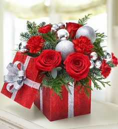 32 Diy Centerpieces For The Jolliest Table Setting Ever, If it comes to this Christmas centerpiece, there isn't any limit to the combinations of flowers you may use. Since Christmas flower arrangements are c. Christmas Flower Arrangements, Christmas Flowers, Christmas Centerpieces, Xmas Decorations, Floral Arrangements, Christmas Wreaths, Centerpiece Ideas, Wedding Decorations, Christmas Projects