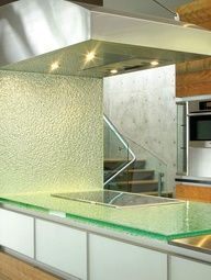 Although glass remains a niche material for kitchen countertops, it's been recently used by more than half of kitchen designers as a backsplash material.