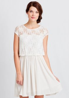 Vibrant and flowy, this smooth-as-silk white dress features a sheer lace overlay at the bodice with a floral motif. Perfected with an illusion neckline and a back keyhole with button closure, t...