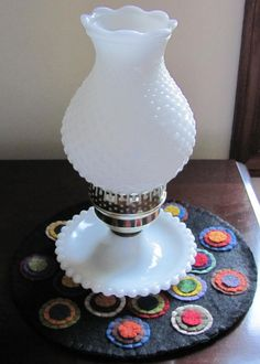 Vintage White  Milk Glass Hobnail Lamp.  Hobnail glassware gets its name from the studs, or round projections, on the surface of the glass. These studs were thought to resemble the impressions made by hobnails, a type of large-headed nail used in bootmaking.  Fenton Art Glass introduced Hobnail Glass in translucent colors in 1939 & Milk Glass Hobnail in 1950