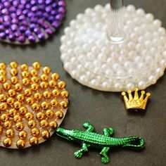 Reuse Mardi Gras beads as coasters. But wait - there's more! I think the beads could also be glued to canvas in the same way for awesome art!