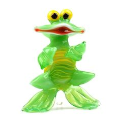 """""""Dancing Green Glass Frog Item No. GF00570A01 $13.29 Hand-blown light green #Happy #Frog glass figurine from St. Petersburg, Russia. This collectible glass-blown figurine makes a great gift, and definitely is a conversational piece. Because each figurine is crafted by hand no two are exactly alike. All pieces are produced in limited quantities."""" Glass Frog, Blown Glass Art, Glass Figurines, Glass Collection, Green Colors, Great Gifts, Petersburg Russia, Dance, Crafts"""