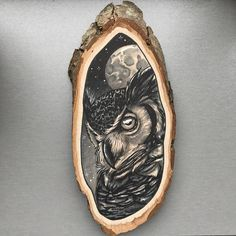Large wood slice with an original drawing of an owl