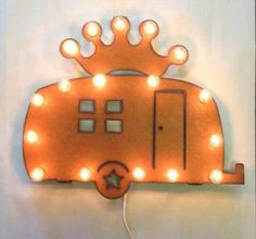 This camper airstream sign with crown comes brand new in a box. It's on vintage distressed metal with light bulbs lighting it up. Only $159.90!