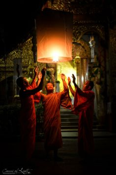 Onwards and Upwards: Ready for 2014 - Thai monks releasing a lantern during Yi Peng festival in Chiang Mai -