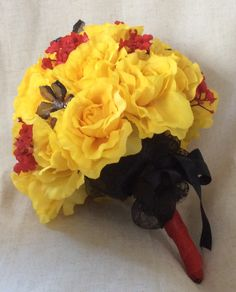Yellow roses, red gip with black jewellery and black netting finish by Cathey's flowers