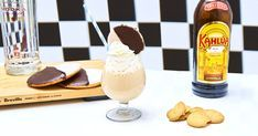 This milkshake version of a White Russian transforms the classic cocktail into a boozy dessert, complete with a black and white cookie on top.