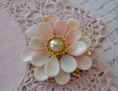 Vintage Shell Flower Brooch: I love vintage jewelry and am in love with brooches (I'm sure my husband thinks I have too many). This one is lovely!