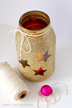 diy-gold-glitter-mason-jars-centerpiece    MAYBE HEARTS INSTESAD OF STARS TO ALLOW LIGHT TO COME THROUGH THE PAINTING (OR ANY TYPE OF WRAP W USE)