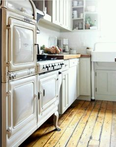 Heart pine floor, vintage stove, and farmhouse sink (I don't even mind how the cabinet looks under the sink - as long as it has the legs, too!)