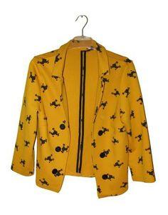Blazer amarilla estampado perros negros de H&M
