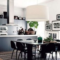 Black and white, sleek surfaces, a hint of rattan and greens create a sophisticated atmosphere I truly can't resist..