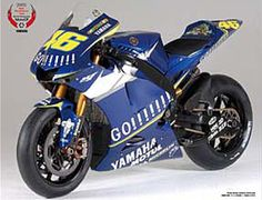 The Tamiya Yamaha YZR-M1 2005 No.46 Rossi in 1/12 scale from the plastic motorcycle model range accurately recreates the real life racing motorcycle that was rode by Valentino Rossi during the 2005 Moto GP season.