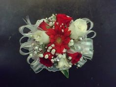 gerbera daisy wristlets   ... Corsage (red and white roses with mini-gerbera daisy wristlet