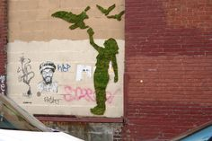 NYC-based, eco-minded guerrilla street artists Edina Tokodi and József Vályi-tóth of Mosstika Urban Greenery use—not paint, but—living grass and moss to create 'living' and 'natural' graffiti.