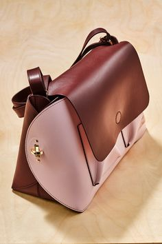 """One bag, two ways. This versatile (and reversible) flap bag is her new """"it"""" bag."""