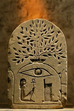 virtual-artifacts:  Sandstone stela to the the god Osiris.   Photo by Kenneth Garrett This stela is very unusual, it'd be great to get some informations about it. Any ideas?    picaresquemusings: it's not about the carvings. I mean, this pattern is unusual. I have never seen such combination before :)