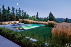 """""""My architecture is always optimistic,"""" says Kundig. """"But a good house has to reflect the good energy of the client."""" The pool and the south terraces were designed for privacy and views. Michael Schultz handled the plantings. Richard Schultz furniture."""
