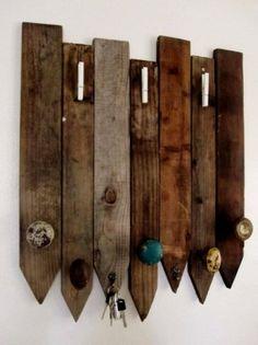 coat rack using old door knobs and fencing by lucinda