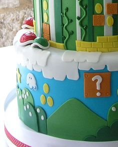engagement// would do adventure time// Mario - This groom's princess had a Peach of a surprise for him at the wedding reception!  The self-professed 'Nerd' found that the wedding cake was a classic gamer's dream.  Using old gamer magazines that the bride brought in for the consultation, we created this Mario Brothers landscape.