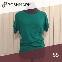 Green Xhiliration Top This Kelly green top is cute and flattering. The sleeves are rolled and loose. There is a wide band at the bottom of the shirt, allowing you to wear it at your hips and have the shirt gather, or wear it long with leggings! Size small, and while it's slim fitting, I was able to wear this into my second trimester of pregnancy (snugly) because of the blousing! Xhilaration Tops Blouses