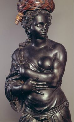 """Andrea Brustolon. Large porte-vase (""""vase support"""") in the form of a draped woman standing on a cylindrical base. Italy (1680s) Ebony and Boxwood, 200cm. Museo del Settecento Veneziano, Ca'Rezzonico. Salone da Ballo. The Image of the Black in Western Art Research Project and Photo Archive, W.E.B. Du Bois Institute for African and African American Research, Harvard University"""