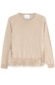 Trimmed with tonal marabou feathers, Simone Rocha's pale peach pullover is made from a luxe wool-silk blend #Stylebop