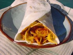 Fritos Chili Cheese Wrap...    http://www.copykat.com/2009/08/05/sonic-drive-in-fritos-chili-cheese-wrap/