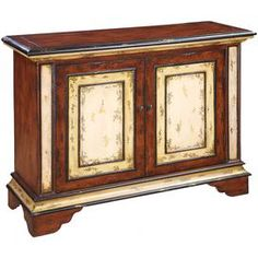 "Two-door console with two-toned panels and a removable shelf.       Product: Console table  Construction Material: Wood    Color: Distressed ivory and brown       Features:   Heavily distressed finish  Two doors  One removable shelf     Dimensions: 32"" H x 42"" W x 15"" D    Note: Assembly required"