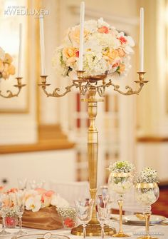 Golden Elegance ~ Keeping the arrangements high is one way to make a wedding opulent and dreamlike. If you use candleabra, you don't have to use as many flowers.