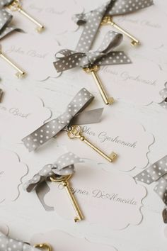 Escort Cards + Golden Keys - LOVE!  See the wedding on SMP - http://www.stylemepretty.com/2013/11/14/toronto-wedding-at-the-burroughs-building-from-mango-studios | Photography: Mango Studios |