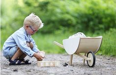JOYS OF CHILDHOOD . Discovering new things and exploring with excitement. An inquisitive mind never stops searching for adventure! Wheelbarrow, Searching, Garden Tools, Exploring, Children, Kids, Baby Strollers, Childhood, Joy
