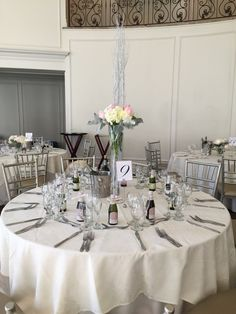 Wedding Flowers: @Aria Prospect CT Centerpieces hi/low White Hydrangea, White & Soft Pink Roses, Birch branches & Dusty miller! With string lightning!  ~Creative Place