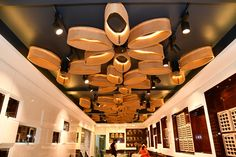 A jewel in the crown of jewellery store accentuates the ambience of retail experience in tier 3 city of Hospet. A.J. Architects, Bangalore. Gold Souk, Jewellery Showroom, Retail Experience, Jewelry Stores, Architects, Chandelier, Crown, Ceiling Lights, Contemporary