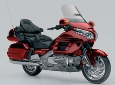 Moto Honda Goldwing. I used to fall asleep as a passenger on this, hated it!