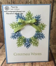 "Just Sponge It- SU Ornamental Pine clear stamp set. I punched a 1 3/8"" circle from the sticky part of a sticky note, added it to the center of my wreath. Stamped 5 Pine cones in Pear Pizzazz slightly overlapping onto the masked circle. Then went and stamped the Marina Mist Pine Cones in between the Pear Pizzazz, took off the sticky note, and wella, you have a wreath! I added my sentiment from the same set and a Pear Pizzazz bow."