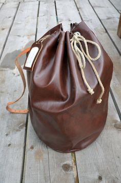 SALE // RARE vintage sailor, army, waterproof backpack, duffle bag, plastic tote, with mono leather strap